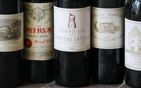 (Left to right) Chateau Lafite-Rothschild, 1996, £700, Chateau Petrus, 1988, £750, Chateau Latour 1982, £1,440, Chateau Margaux, 1985, £300, Chateau Haut-Brion, 1990, £500. All prices are per bottle and are based on the wine being, 'under bond.' Photographed at Roberson Wine Merchant, on High Street Kensington, Tuesday, 11 March 2008. Ph: Rebecca Reid